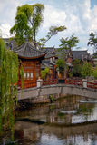 Wooden houes in Chinese style, picturesque bridge across the river in China Royalty Free Stock Images