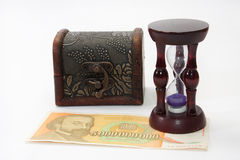 Wooden hourglass on the 5 bilion bill with wooden chest in the b royalty free stock images