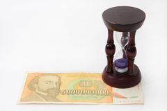 Wooden hourglass with 5 billion bill Stock Photography