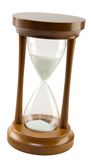 Wooden Hourglass Tilted. Isolated hourglass, tilted with sand counting down the minutes Stock Photos