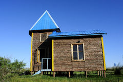 Wooden house. One with a Russian-style wooden house stands in a beautiful nature Royalty Free Stock Photo