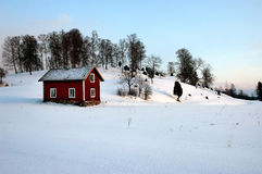 Wooden house. A red wooden house at the countryside, Sweden stock photos