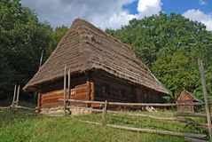 The wooden house. The old wooden house costs on a green hill Stock Photography