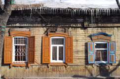 Wooden house. Three windows of wooden house in winter, close up Stock Image