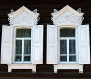 Wooden house. Two windows of wooden house, close up Royalty Free Stock Photos