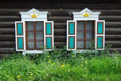 Wooden house. Two windows of wooden house, close up Stock Images