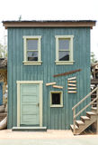 Wooden house. Painted in sage green color Stock Photos