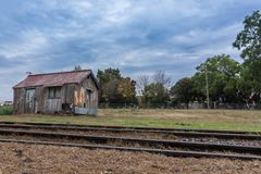Wooden house in abandoned train station royalty free stock images