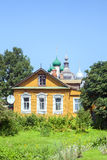 The wooden house against orthodox church in Russian style Royalty Free Stock Image