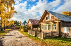 Wooden house of artists in Plios. Wooden house of artists in Russian style in autumn Plyos on a sunny afternoon and Nikolskaya chapel Stock Photography