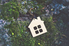 Wooden house as symbol Stock Images