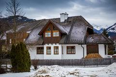 Wooden house in Austrian Alps at snowy day Royalty Free Stock Image