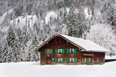 Wooden house in Bavaria in the snow Royalty Free Stock Photos