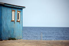 Wooden house on the beach Royalty Free Stock Images