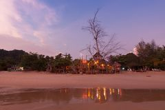 Wooden house on the beach at twilight time . Wooden house on the beach at twilight time Royalty Free Stock Photography