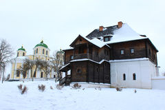 The wooden house and beautiful church in winter Stock Photo