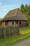 Wooden house in beautiful garden Stock Image