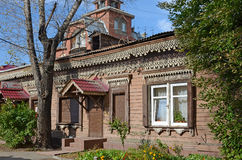 Wooden house with beauty carving and modern jalousie on Irkutsk street Royalty Free Stock Photos