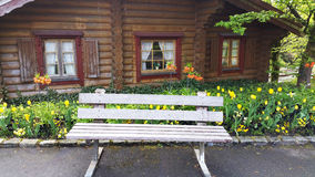 Wooden house with bench . Stock Image