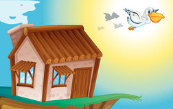 Wooden house and birds Royalty Free Stock Photo