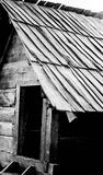 Wooden house. Black and white picture of an old wooden house. Monochrome photography stock image