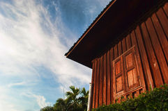 Wooden house and blue sky Royalty Free Stock Image