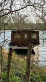 Wooden house boat. At edge of swollen vienne river france Stock Photos