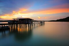 Wooden House in Body of Water during Sunset Photo Royalty Free Stock Image