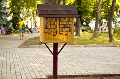 Wooden house for books in park Stock Photo
