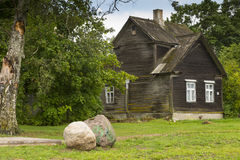 Wooden house and boulders Stock Photo
