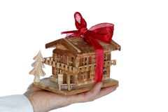 Wooden house with bow Royalty Free Stock Photography