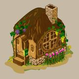 Wooden house with a brick chimney. And carved Windows. With beautiful front garden, flowers, grapes on thatched roof and grass. With a mailbox Stock Photos