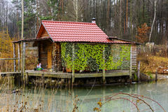 Wooden house built on the shore of Lake Stock Image