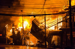 Wooden house burning.fire Stock Photos