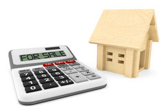Wooden House with Calculator Royalty Free Stock Photography