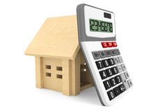 Wooden House with Calculator Stock Image