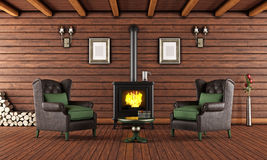 Wooden house with cast iron fireplace Royalty Free Stock Images