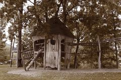 Wooden house on the children`s playground in summer royalty free stock photos