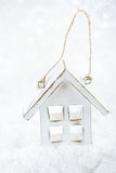 Wooden house christmas decoration on white snow Stock Image