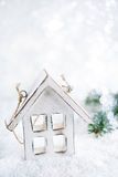 Wooden house christmas decoration on white snow background Royalty Free Stock Photo