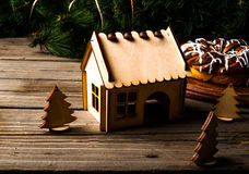 Wooden house and Christmas trees Stock Photos