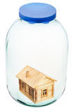 Wooden house in closed glass jar Royalty Free Stock Photography