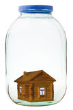 Wooden house in closed glass jar Stock Images