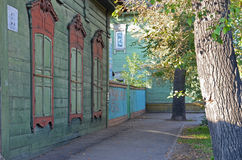 The wooden house with closed window shutters on Irkutsk street Royalty Free Stock Photography