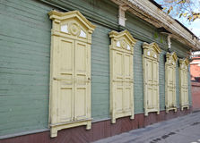 The wooden house with closed window shutters on Irkutsk street Royalty Free Stock Images
