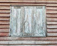 Wooden house and closed windows. Wooden house closed windows home wall design architecture background aged old vintage retro style rough pattern culture stock photos