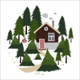 Wooden house in the coniferous forest. Royalty Free Stock Images