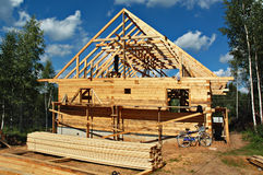 Wooden house construction. A wooden country house under construction royalty free stock images
