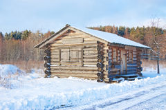 The wooden house costs in  winter near  forest  Royalty Free Stock Photos