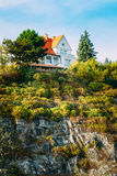 Wooden house cottage on top of cliff or rock Royalty Free Stock Image